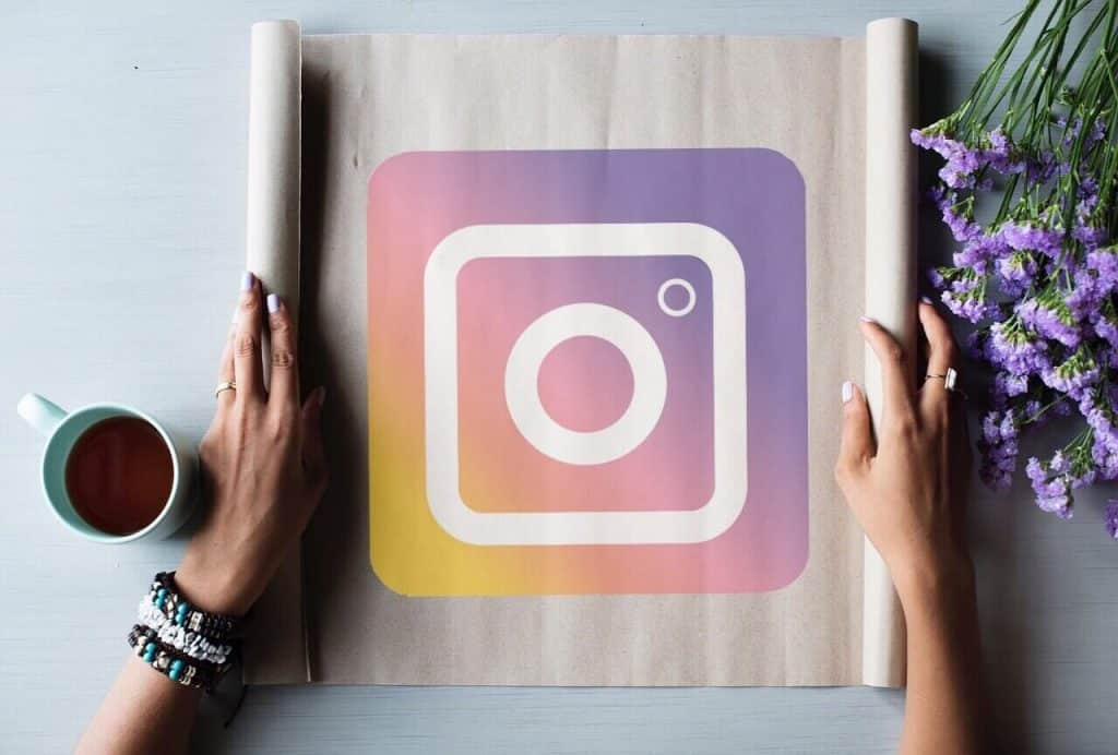 Paper scroll rolled out with Instagram logo.